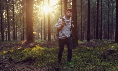 hiker with backpack is walking in the forest on a sunny day - traveler exploring landscape concept image- Stock Photo or Stock Video of rcfotostock | RC-Photo-Stock