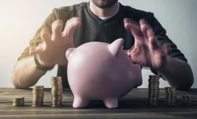 hipster hand taking care of piggy bank- Stock Photo or Stock Video of rcfotostock | RC-Photo-Stock