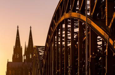Hohenzollern Bridge and cathedral tops at sunset- Stock Photo or Stock Video of rcfotostock   RC-Photo-Stock