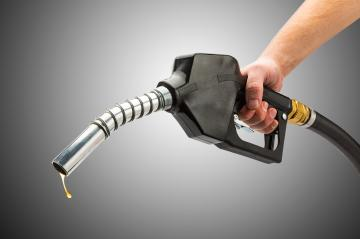 holding a gas pump nozzle- Stock Photo or Stock Video of rcfotostock | RC-Photo-Stock