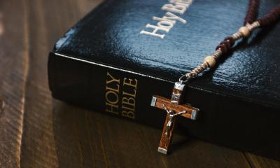 Holy Bible with crucifix on wooden table- Stock Photo or Stock Video of rcfotostock | RC-Photo-Stock