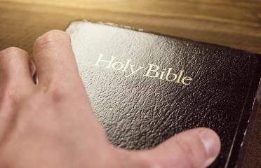 Holy Bible with hand- Stock Photo or Stock Video of rcfotostock | RC-Photo-Stock