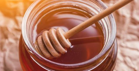 Honey Dipper in a jar with fresh honey- Stock Photo or Stock Video of rcfotostock | RC-Photo-Stock