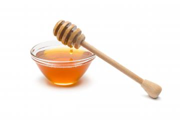 honey dipper with honey in a shell- Stock Photo or Stock Video of rcfotostock | RC-Photo-Stock