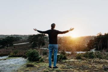 Hopeful thoughtful woman with open arms holds out her hands in the air. Person in nature is relaxed, peaceful, determined, full of hope and enjoys life.- Stock Photo or Stock Video of rcfotostock | RC-Photo-Stock