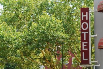 hotel sign at summer. copyspace for your individual text.- Stock Photo or Stock Video of rcfotostock | RC-Photo-Stock