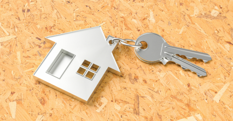 House as a pendant on a key on plywood floor as a house purchase and housing concept- Stock Photo or Stock Video of rcfotostock | RC-Photo-Stock
