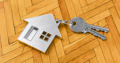House as a pendant on a key on wooden floor as a house purchase and housing concept- Stock Photo or Stock Video of rcfotostock | RC-Photo-Stock