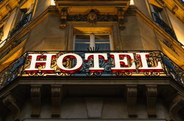 Illuminated hotel sign taken at night- Stock Photo or Stock Video of rcfotostock | RC-Photo-Stock