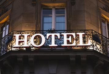 Illuminated hotel sign taken in Paris at night- Stock Photo or Stock Video of rcfotostock | RC-Photo-Stock
