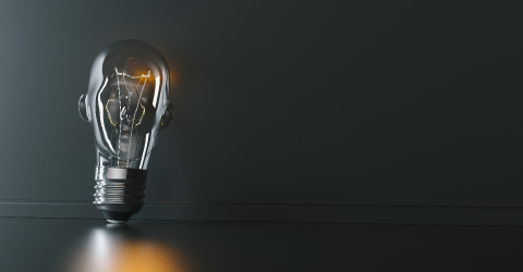 Illuminated light bulb with head shape leaning against a wall, concept for creativity, innovation and solution, copyspace for your individual text.- Stock Photo or Stock Video of rcfotostock | RC-Photo-Stock