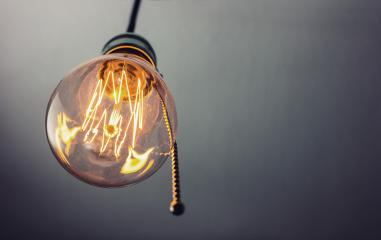 illuminated vintage hanging light bulb with pull switch- Stock Photo or Stock Video of rcfotostock | RC-Photo-Stock
