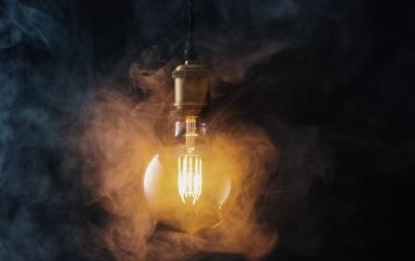 illuminated Vintage hanging light bulb with steamysmoke- Stock Photo or Stock Video of rcfotostock | RC-Photo-Stock