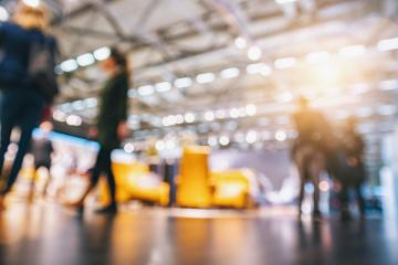 Intentionally blurred background crowd of people walking at a trade show - Stock Photo or Stock Video of rcfotostock | RC-Photo-Stock