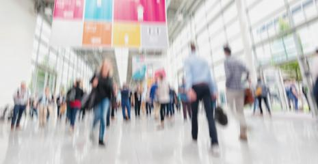 Intentionally blurred people walking trade show floor- Stock Photo or Stock Video of rcfotostock | RC-Photo-Stock