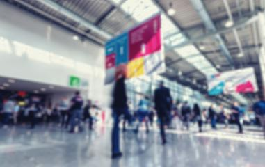 Intentionally blurred trade show visitors in a modern environment background- Stock Photo or Stock Video of rcfotostock | RC-Photo-Stock