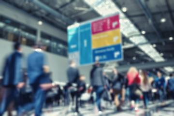 Intentionally blurred trade show visitors walking background image- Stock Photo or Stock Video of rcfotostock | RC-Photo-Stock