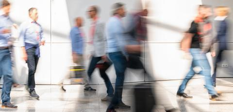 International anonymous crowd on the escalator of a trade fair- Stock Photo or Stock Video of rcfotostock | RC-Photo-Stock
