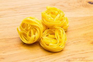 Italian egg pasta nest- Stock Photo or Stock Video of rcfotostock   RC-Photo-Stock
