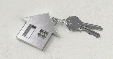 Keys with house shaped keychain on a concrete floor as a house purchase and housing concept- Stock Photo or Stock Video of rcfotostock | RC-Photo-Stock