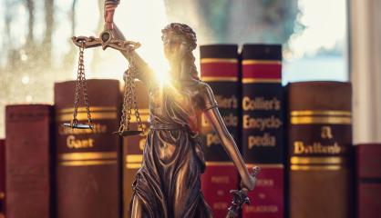 Lady Justice (Justitia) with law books  in a lawyer office : Stock Photo or Stock Video Download rcfotostock photos, images and assets rcfotostock | RC-Photo-Stock.:
