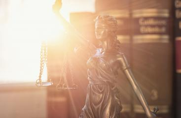 Lady Justice (Justitia) with law books- Stock Photo or Stock Video of rcfotostock | RC-Photo-Stock
