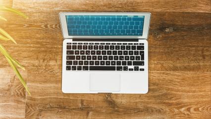 Laptop on Vintage Wooden desktop- Stock Photo or Stock Video of rcfotostock | RC-Photo-Stock