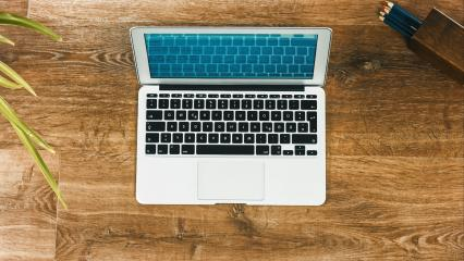 Laptop on Vintage Wooden desktop- Stock Photo or Stock Video of rcfotostock | RC-Photo-Stock