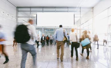 large crowd of anonymous blurred people at a trade fair, including banner with Copy space- Stock Photo or Stock Video of rcfotostock | RC-Photo-Stock