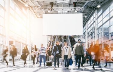 large crowd of anonymous blurred people at a trade fair, including copy space banner- Stock Photo or Stock Video of rcfotostock   RC-Photo-Stock