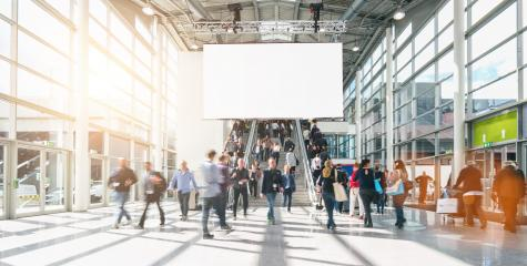large crowd of anonymous blurred people at a trade show, including copy space banner - Stock Photo or Stock Video of rcfotostock | RC-Photo-Stock