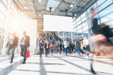 large crowd of anonymous blurred people in a modern hall- Stock Photo or Stock Video of rcfotostock | RC-Photo-Stock
