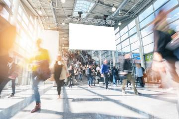 large crowd of anonymous blurred people walking at a trade show- Stock Photo or Stock Video of rcfotostock | RC-Photo-Stock