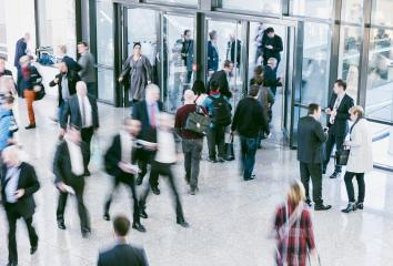 large crowd of blurred people in a trade fair hall- Stock Photo or Stock Video of rcfotostock | RC-Photo-Stock