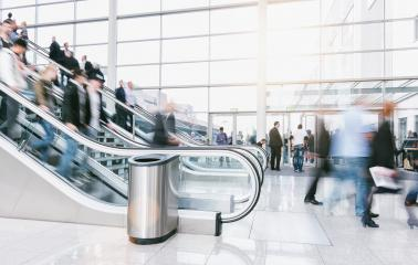 large crowd of blurred people rushing on escalators at a trade fair hall- Stock Photo or Stock Video of rcfotostock | RC-Photo-Stock