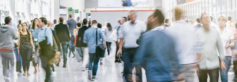 Large crowd of business people walking at a trade fair- Stock Photo or Stock Video of rcfotostock | RC-Photo-Stock