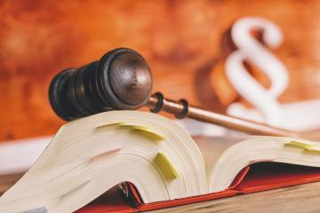 law book with gavel and paragraph symbol in court office - law concept image- Stock Photo or Stock Video of rcfotostock | RC-Photo-Stock