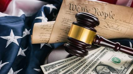 law gavel with money on the usa flag with American Constitution- Stock Photo or Stock Video of rcfotostock | RC-Photo-Stock