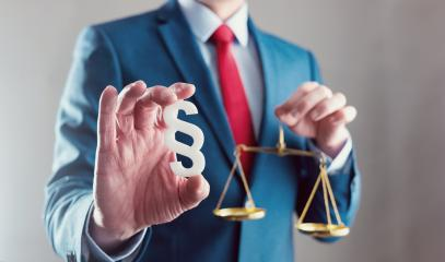 lawyer holding libra with paragraph symbol - law concept image- Stock Photo or Stock Video of rcfotostock | RC-Photo-Stock