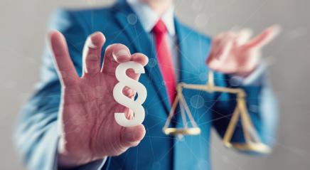 lawyer holding scale with paragraph sign - law concept image- Stock Photo or Stock Video of rcfotostock | RC-Photo-Stock