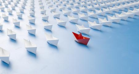 Leadership concept, red leader paper boat leading whites- Stock Photo or Stock Video of rcfotostock | RC-Photo-Stock