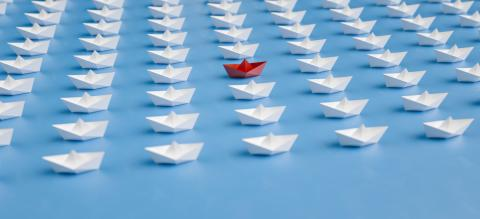 Leadership concept, red paper ship leader, standing out from the crowd of whites boats- Stock Photo or Stock Video of rcfotostock | RC-Photo-Stock