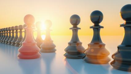 Leadership concept, red pawn of chess, standing out from the crowd with sunflare- Stock Photo or Stock Video of rcfotostock | RC-Photo-Stock