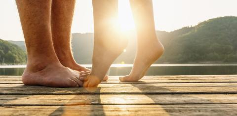 Legs on jetty. A young loving couple hugging and kissing on the pier on a lake at sunset. Two lovers, man and woman barefoot near the water on a jetty. Happy love moments together. : Stock Photo or Stock Video Download rcfotostock photos, images and assets rcfotostock | RC-Photo-Stock.: