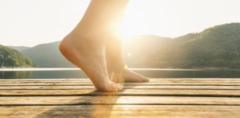 Legs on jetty from a young woman at sunset. yoga concept image : Stock Photo or Stock Video Download rcfotostock photos, images and assets rcfotostock | RC-Photo-Stock.: