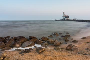 lighthouse at a stony beach : Stock Photo or Stock Video Download rcfotostock photos, images and assets rcfotostock | RC-Photo-Stock.: