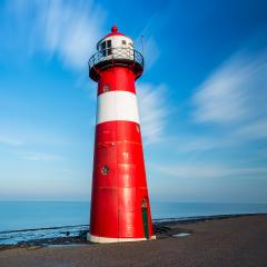 lighthouse at the sea with cloudy sky- Stock Photo or Stock Video of rcfotostock | RC-Photo-Stock