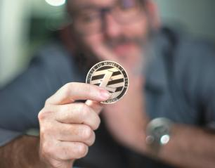Litecoin cryptocurrency in hand of a casual businessman - Stock Photo or Stock Video of rcfotostock | RC-Photo-Stock
