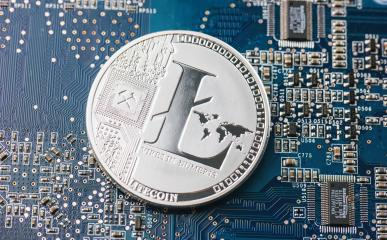 Litecoin on motherboard- Stock Photo or Stock Video of rcfotostock | RC-Photo-Stock
