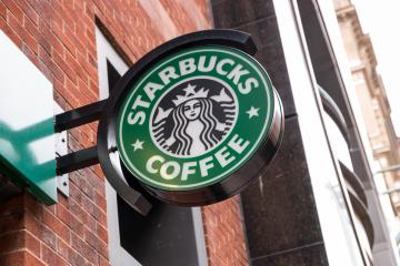 LONDON, UNITED KINGDOM MAY, 2017: Logo of a Starbucks Coffee coffeehouse. Starbucks is the largest coffeehouse company in the world, Founded in Washington, 1971. : Stock Photo or Stock Video Download rcfotostock photos, images and assets rcfotostock | RC-Photo-Stock.: